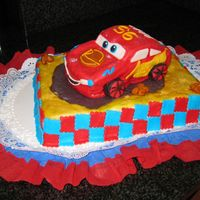 Cars Cake I'm not really happy with the cake, but it is practice...the fondant is not smooth like I wanted.
