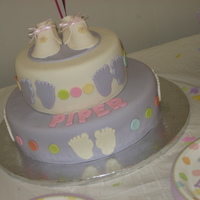 Baby Piper Baby shower cake for a friend. Home made mmf to match the plates. Gumpaste booties.