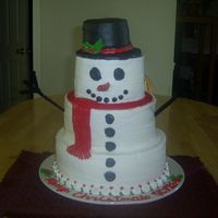 Snowman  white cake with oreo cookie filling ... this was sooo much fun to make. 10, 8 and 6 inch cake with oreo cookie filling. Not sure what size...