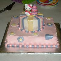 Hello Kitty September 2007 - Bottom tier is chocolate butter cake with cookies 'n' cream filling. Top is white sour cream cake with...