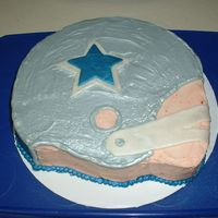 Cowboys Helmet September 2007 - This was made for my brother's b-day. Inspired by many cakes here on CC. Helmet iced in grey butter cream, then went...