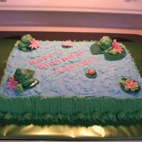 Pond Cake Frogs, lily pads, letters and flowers are fondant. Everything else is Buttercream. Thanks to Allison F. for help with the frogs.