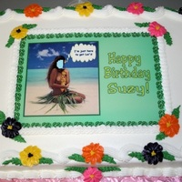 Luau Birthday Cake Cake for a friend who is celebrating her Birthday at a Luau. The face on the image is the Birthday girl, superimposed on the hula girls...