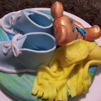 Baby Boy My first time making fondant baby shoes and bear.