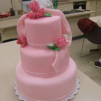 First Wedding Cake This is the first wedding cake that I did in class. I'd love to get some honest opinions. One day I hope to own my own business. I...