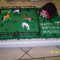 Horse Pasture yellow cake with buttercream icing Fence and horses are plastic Barn is yellow loaf cake cut to shape of Barn and covered with buttercream...