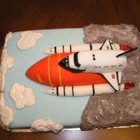 Space Shuttle My daughter's boyfriend works for the Space Center (Nasa) and she wanted to surprise him with this for his Birthday. Yellow cake with...