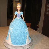 Cinderella Cake I used a regular full size Barbie. Baked the cake in an 8 cup glass measuring cup and also needed an 8 in round layer. I sliced the dress...