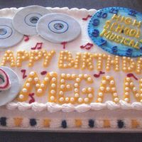 High School Musical 2 I did this cake for my niece. I cut the CD's and the clock from rolled MM fondant. I brushed the clock with blue food coloring and...