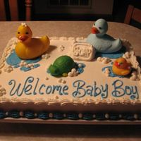 Bathtub Toys This cake was done using a vanilla sheet cake and buttercream icing. Used blue for the water and white for the bubbles. Used a small slice...
