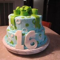 Bow And Dots 16 This stacked cake was done for a Sweet 16 party. Used MMF to do the bow , dots and the 16 that's just leaning on the cake. It was iced...