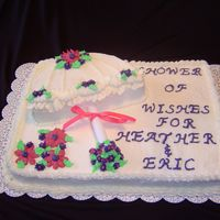 "Umbrella Wedding Shower I made a sheet cake and placed a 9"" round cut in half on top. It is one of my first cakes."