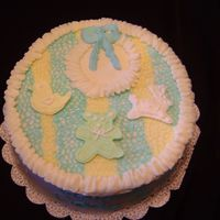 Baby Bib This cake was made to look like a baby bib. The fiqures were made out of colorflow.