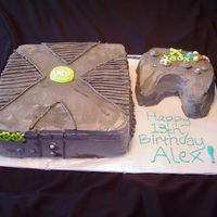 "Xbox Birthday Cake This is a 2 layer 10"" cake for the box and a carved round for the controller. It is frosted in BC."