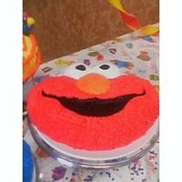 Elmo I made this cake for my husband's grandson first birthday. Big Hit! Lots of compliments from my step-son's family. I was very...