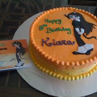 Bratz Cake Chocolate cake, covered with BC. The picture, matching the invitation card, is made of fondant.