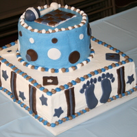 "Blue And Brown Baby Shower Blue and brown baby shower cake made for nephew's baby due in Feb. Two tiers each of 12"" square and 8"" round. Buttercream..."