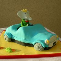 Babar In His Car 2   Babar in his car. Inspired by the cover of the book Babar and his Family.All is fondant and gumpaste. My first carved cake!