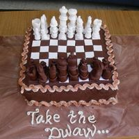 Chess Set 1  Chess set cake made for a chess lover. Yellow cake with chocolate BC and fondant pieces. I was freaking out because the pieces were being...