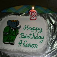 Babar Sheet Cake  Babar on 9x13 cake for my sons party in preschool... used pin prick method to transfer drawing onto cake and was very happy with it. Still...