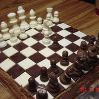 Chess Game Cake This is the cake I made for my grandson's birthday. The chess board and pieces were made in candy molds. The cake was chocolate with...