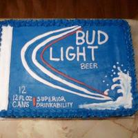 Bud Light   This cake is covered with buttercream icing. The lettering is free-handed