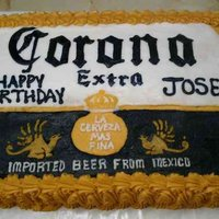 Corona Beer This cake is covered with buttercream icing. The writing and logo is all free-handed