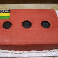 Boral Brick   This is a 7x11 cake made for someone who works at the Boral brick company.. Icing is buttercream. I added fondant for the holes.