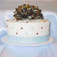 "Happy Birthday In Blue And Brown White and choc cake iced in buttercream for DH birthday. Used an impression mat on the sides and bought a bow for the top. 6"" 2 tier..."