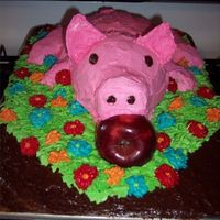 Roasted Pig Front Front of my roasted pig. I used a stainless steel bowl for the body, a small Pyrex bowl on its side for the head, a trimmed cupcake for the...
