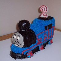 Thomas The Tank Engine Thomas was made using the Wilton Choo-Choo Train pan. I used a pound cake recipe after a collapsing train incident 2 years ago. He's...