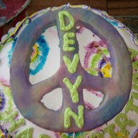 Peace Signs And Tie Dye For my 10 year old neice...peace sign is made of rice krispy treats and modelling choc. with luster dust. the rest of buttercream.