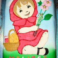 Petit Chaperon Rouge White sponge cake filled with butter cream and covered with sugar paste.