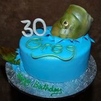 Catching Fish This cake was great fun! Catching a fish. The fish head has a foam core with gumpaste and then covered in fondant and spray painted.