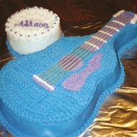 Guitar Birthday Cake  Colors picked by little girl--not me, but it turned out really cute. She is a music lover who just started taking lessons. Strings are...