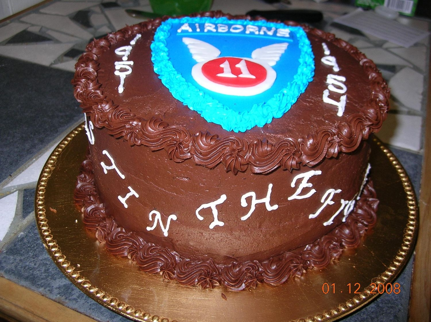 11Th Airborne Birthday   Chocolate cake w/ chocolate icing. Airborne patch is made of fondant.