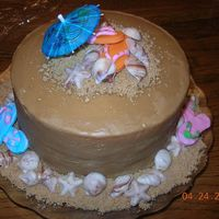 Beach-Themed Caramel Cake For Relay For Life  Caramel cake with chocolate shells and fondant flip-flops for a Relay for Life competition. My daughter's principal asked me to make...