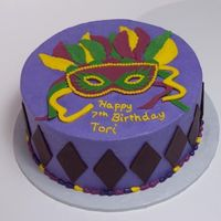 Mardi Gras Birthday Party Buttercream icing with fondant accents
