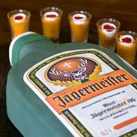 Jagermeister & Jager Bombs Jagermeister cake covered in fondant, with edible image label. The jager bombs are colored cake in real shot glasses. I created smaller...