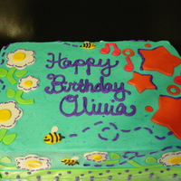 Olivia's Birthday Cake My SIL's sister ordered this cake for her dd's 7th birthday. It was supposed to be for two girls. One of them wanted a garden...