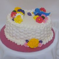 Wilton Course 2 Flower Cake This is my final cake from the Wilton Course 2 class. The flowers were made using royal icing The bird was made using color flow.