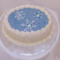 Snowflake Cake This cake has royal icing snowflakes and cake sparkles on top.