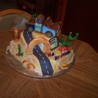 Mater & Mcqueen   This was a cake I did for my newphews 2nd birthday. The Mater is a night light he was to use in his room.