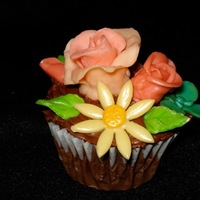 Chocolate Cupcake With Starburst Candy Decorations What kid wouldn't like cupcake decorations made from Starburst candies? Chocolate cupcake has baked cream cheese and coconut filling...