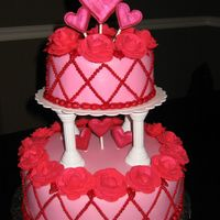 Course 3 Final Cake Tonight I made my final cake for course 3. I covered it in MMF, roses are made of royal icing, hearts made of color flow, both covered in...