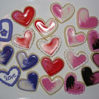 Small Valentine Hearts No-Fail sugar cookies. I used a combination of Toba Garrett's glace icing, antionia74's icing, and royal icing flowers I made...