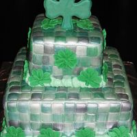 St. Patrick's Day Cake This is covered in MMF and painted with a few colors of luster dust, then the whole thing painted with super pearl luster dust. Royal icing...
