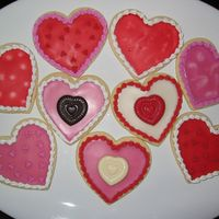 Valentine Hearts Just some more no-fail cookies, with Toba's and antonia74's icing. I made the heart candies with candy melts and a Wilton lolipop...