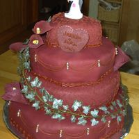 Maroon Weddingcake With Silversparkling Ivy This is a wedding cake made for 70 guest. It was made out of sugarpaste colored in a maroon tint made to match the brides bouquet. On the...