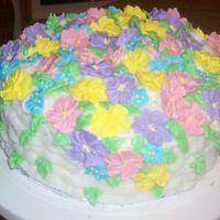 Basket Of Flowers I MADE THIS CAKE FOR ONE OF THE GIRLS I WORK WITH. I HAD DONE BASKETWEAVE BEFORE, SO I WAS CONFIDENT THAT IT WOULD BE PRETTY EASY. IT WAS...